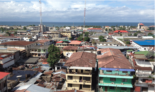 Standing on the balcony at the Dept. of Education in Monrovia, you see a tattered yet beautiful town.