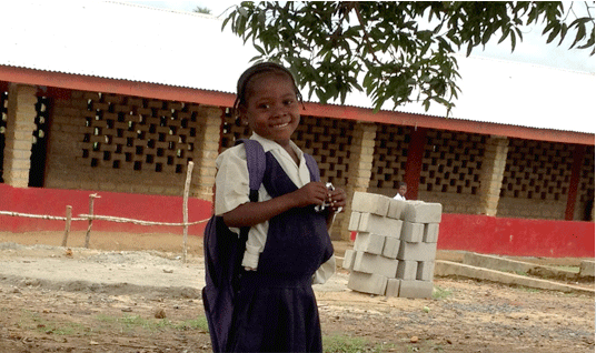 A young girl studying at the Save the Children school in Liberia
