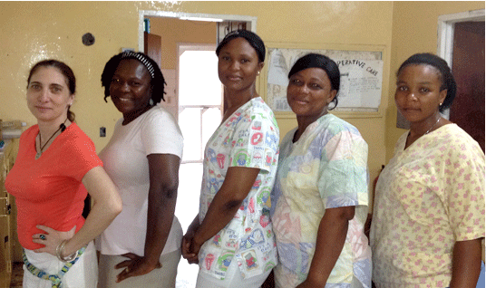 Exec. Director Lisa Bernstein (left) with nursing team of the Pediatric Unit at a small hospital in Liberia